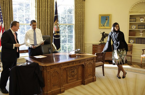 obama with michelle and staff member