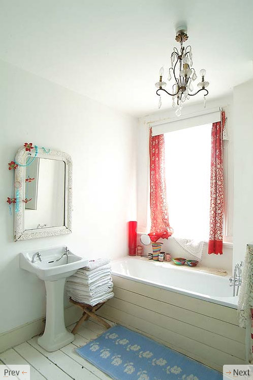 white bath red curtains