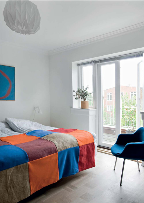 blue and orange are the accent colors which layer this room nicely by