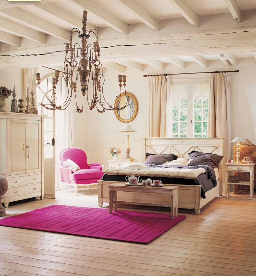 Luxury-modern-bedroom-design-with-double-bed-colorful-bedding-pillows-bedside-tables-pink-chair-and-carpet