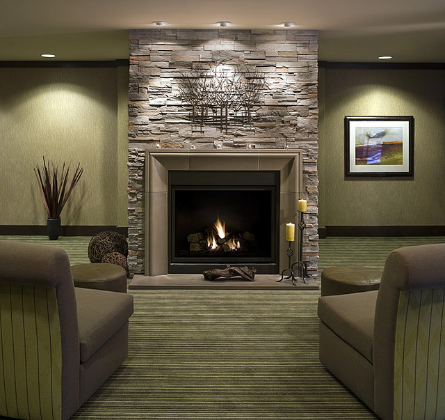 Tiled stone design with black electric fireplace for living room - Decorating Ideas For Fireplace Walls Dream House Experience