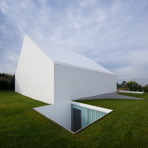 stark facade with opening