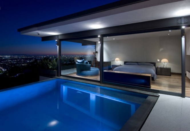 bedroom overlooks illuminated pool