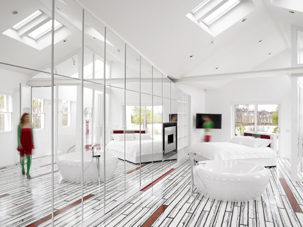 white bedroom is bright with windows