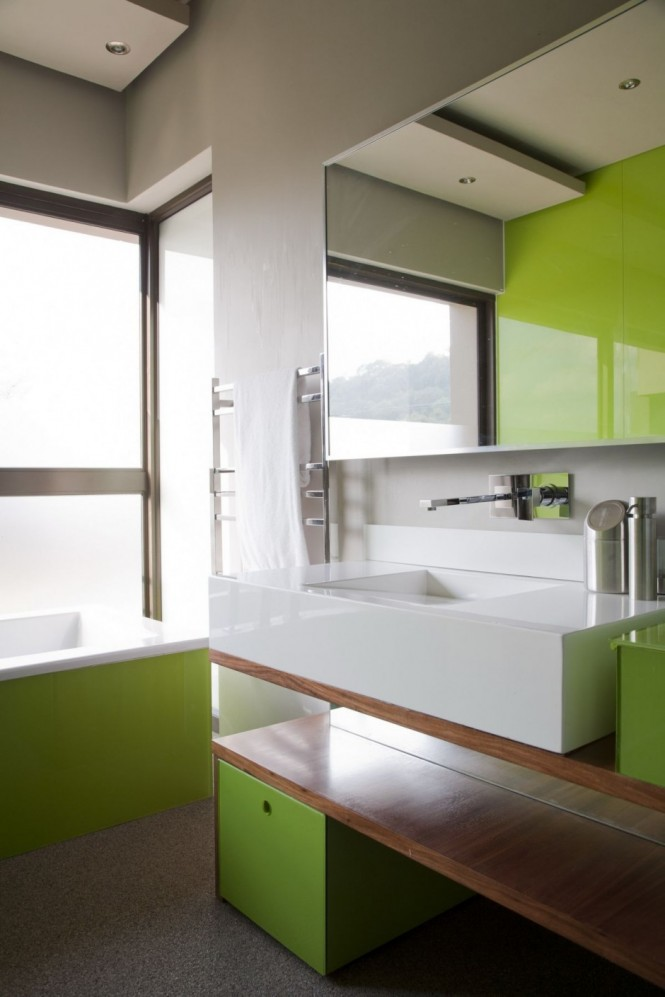 The bathroom also includes a sliding panel that opens up to one of the trees outside. The bidet and toilet are housed in an enclosure within the bathroom.