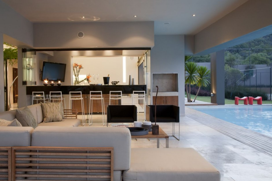 The pool deck is a play on outdoor-indoor. The den or deck area is easily accessible to the infinity pool area.