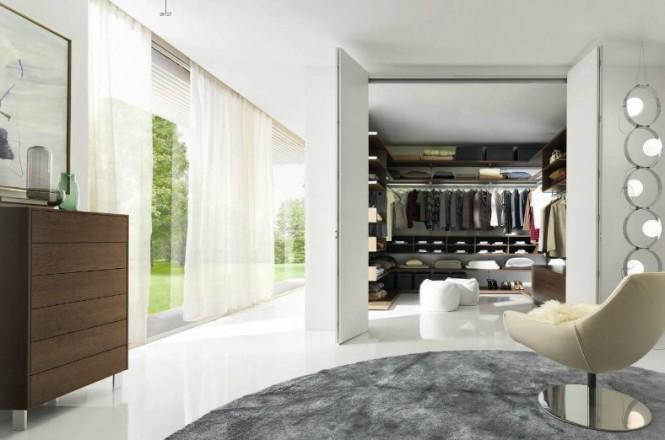 This is a small walk-in built into a wide wall off the side of the bedroom but still has a seating area, which can easily become part of the closet by opening the doors, or separate by closing them.