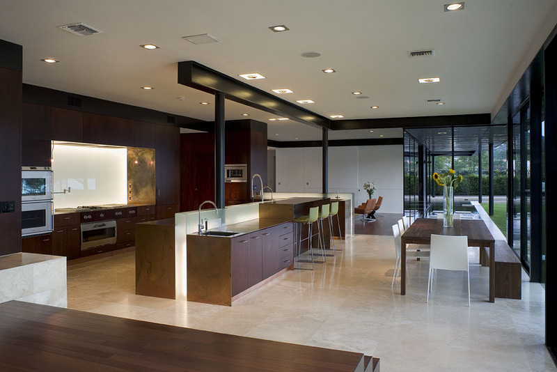 The modern and sleek open kitchen and dining area.