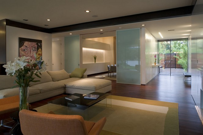 Though more modern, the interior design still retains the coziness of a vacation getaway home by the lake.
