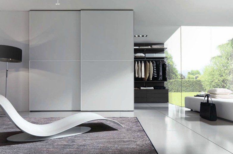 This luxurious closet can be closed off by sliding the large panel doors over.