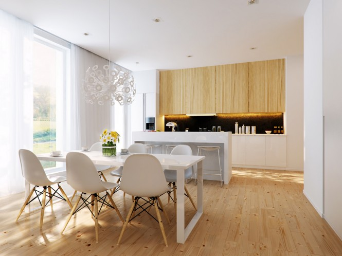 A beautiful light wood floor matches the kitchen cabinetry. The cupboards are simple and modern, yet still evoke a sense of the traditional country kitchen. A white island partially separates the kitchen from the dining area.
