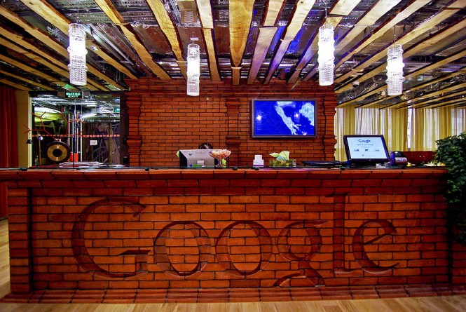 Google employees are welcomed by this brick-lined front desk at the entrance, which sets the laid-back tone of the whole office space.