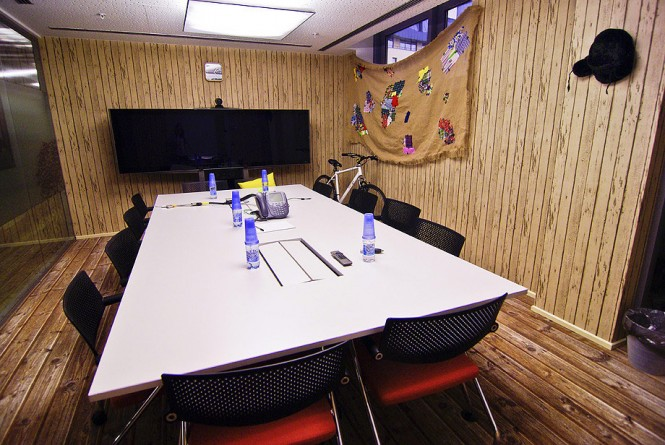 A more official meeting space includes a larger table and seating for more people.