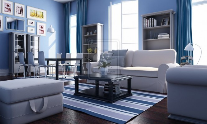 This is a blue and white, nautical, beach-house living room complete with striped rug, comfortable white furniture, and beachy wall art.