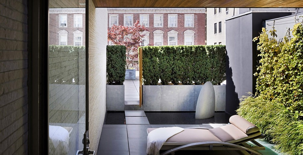 Another thing you may considering doing with a rooftop garden, is adding high shrubbery to ensure more privacy in a certain nook or space of the roof.