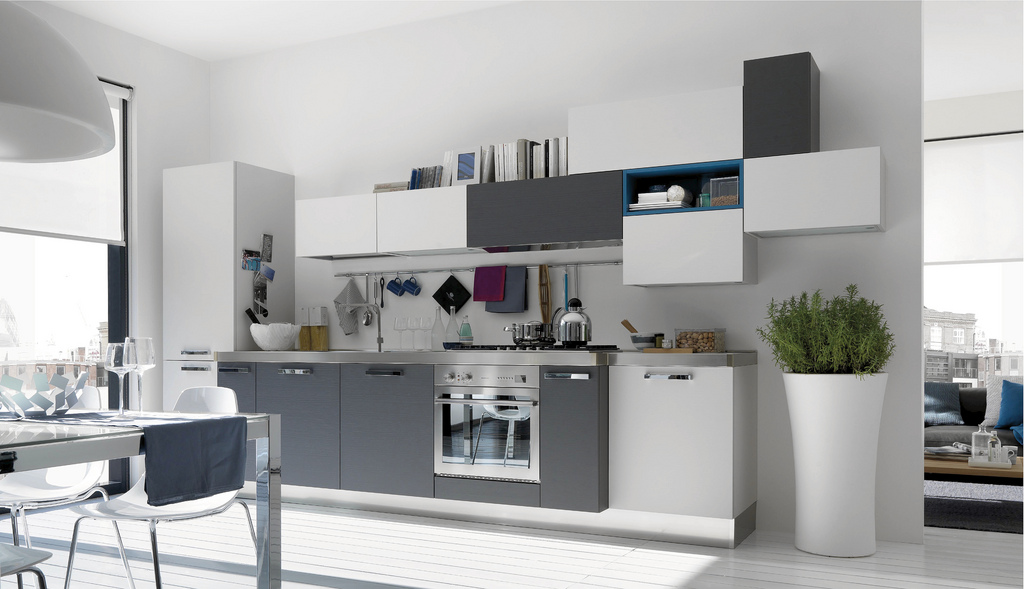 The cabinetry here is interesting, jumping from white to grey to blue