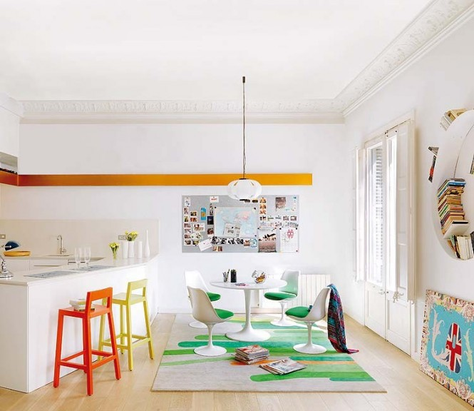 The bar stools mismatch in color while the breakfast nook holds its own with green and white mod decor.