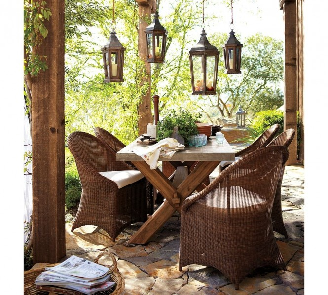 Wicker works, especially with a rustic country house such as this one, with its stone floors and hanging lanterns.