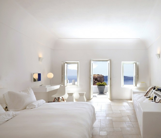 The simple, white decor of the interiors mimics the monochromatic style characteristic of the island.