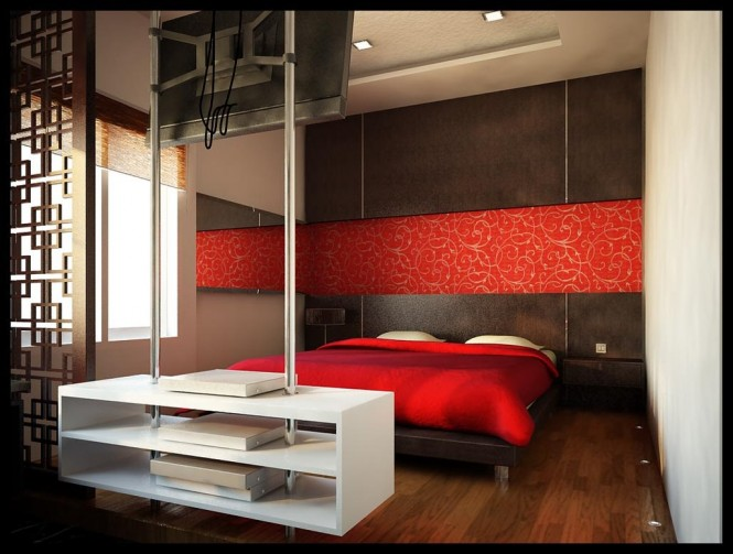 Design by San Samuel. This ultra modern red and white bedroom is accented by dark wooden wall panels and matching floor. The red banner with a graphic white design running across the wall,  opens up the space even more.
