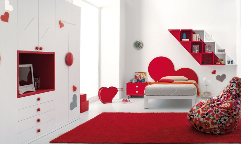 this quirky red and white bedroom incorporates heart cut out designs