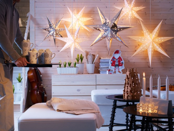 If space is limited, decorating with light can be a terrific solution to twinkle your way through December, using hanging star lights with pretty cuts outs, and adding a sprinkling of candle light to create the ultimate cozy factor.