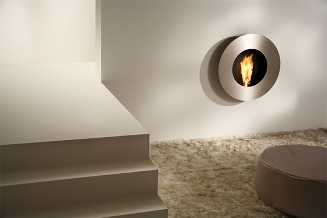 This gorgeous circular fireplace is reminiscent of a porthole window.