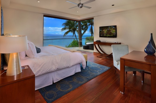 Each bedroom is an oceanfront master suite with views of neighboring island Lanai and glimpses of Molokai. The rooms, complete with luxurious bath and wet bar, are accessorized with seashells to bring the beach scene indoors, and furnishings are simple but sumptuous with plush headboards and flat screen TVs.