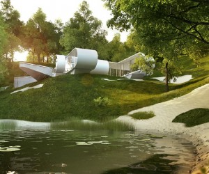 This stunning piece of modern architecture takes on a space age look, with huge windows that follow the curve of the walls, giving the building a thin picture frame edge.