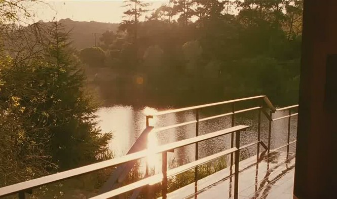 The stunning riverside views from the decked entrance set a secluded scene for the intense movie plot