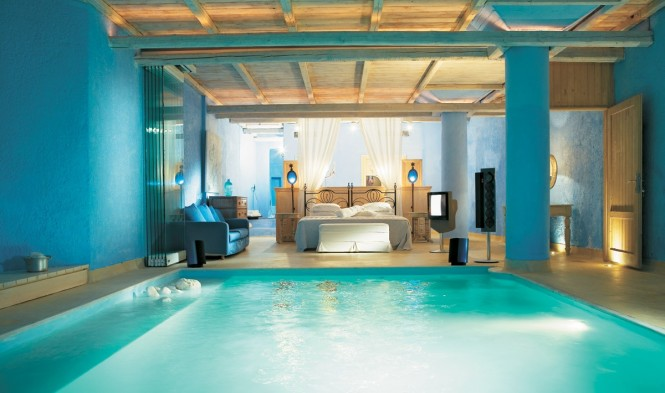 This suite in Mykonos Blu Resort in Mykonos Island, Greece, offers a pool at the foot of the bed; great for a refreshing early morning plunge, not so great for sleep walkers.