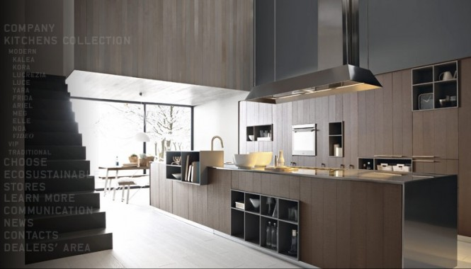 There are a great range of finishes here such as the beautifully toned Cognac Oak slab doors, which are modern sophistication itself when topped with a stainless steel work surface and matching cooker hood.