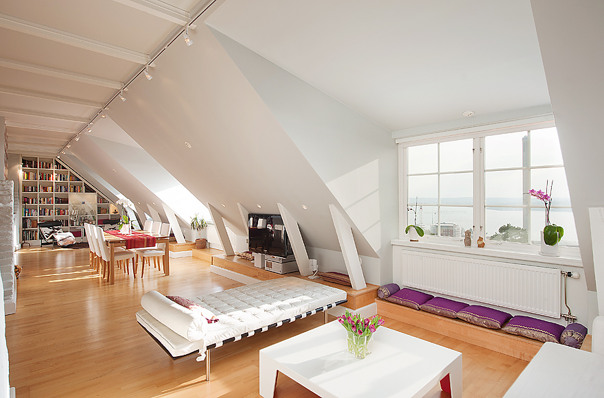 Stockholm attic with stepped walls steep ceilings for Attic room decoration