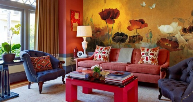 A wall-to-wall flower mural creates a dramatic backdrop in this living room, and ties in the black, red and cream color story.
