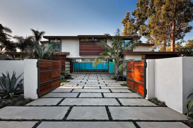 Contemporary paved driveway wooden gates