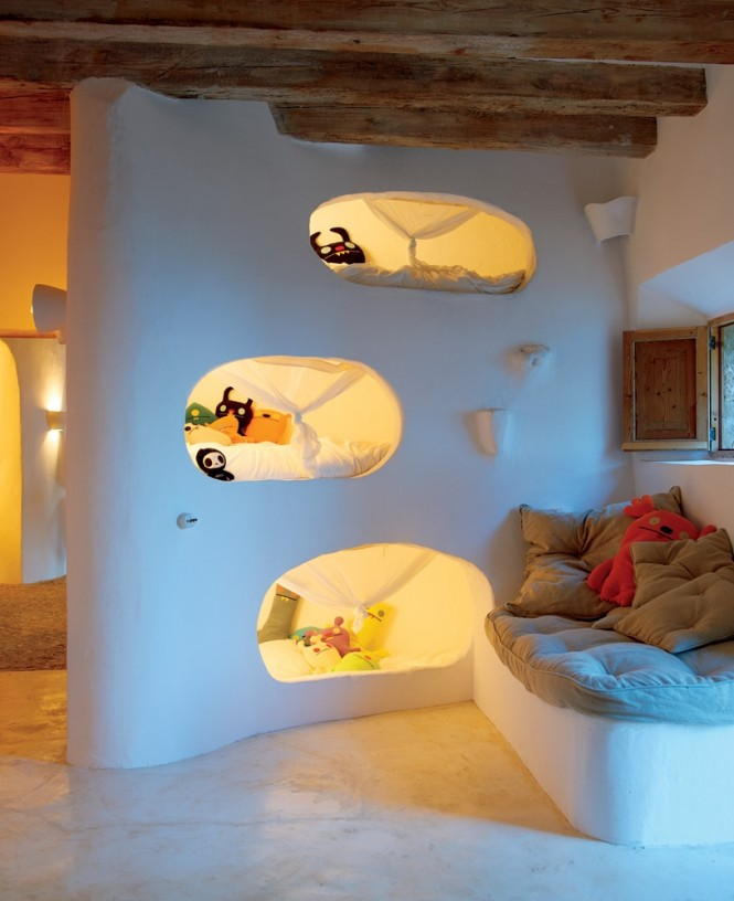 From Coastal Cave House of French Designer Alexandre de BetakBunk beds have come a long way in recent years, taking on many different shapes and forms. These foldaway Lollisoft IN bunks offer a neat solution for occasional guest sleeping arrangements, slipping away quickly, discreetly, and very stylishly, when no longer desired for use.