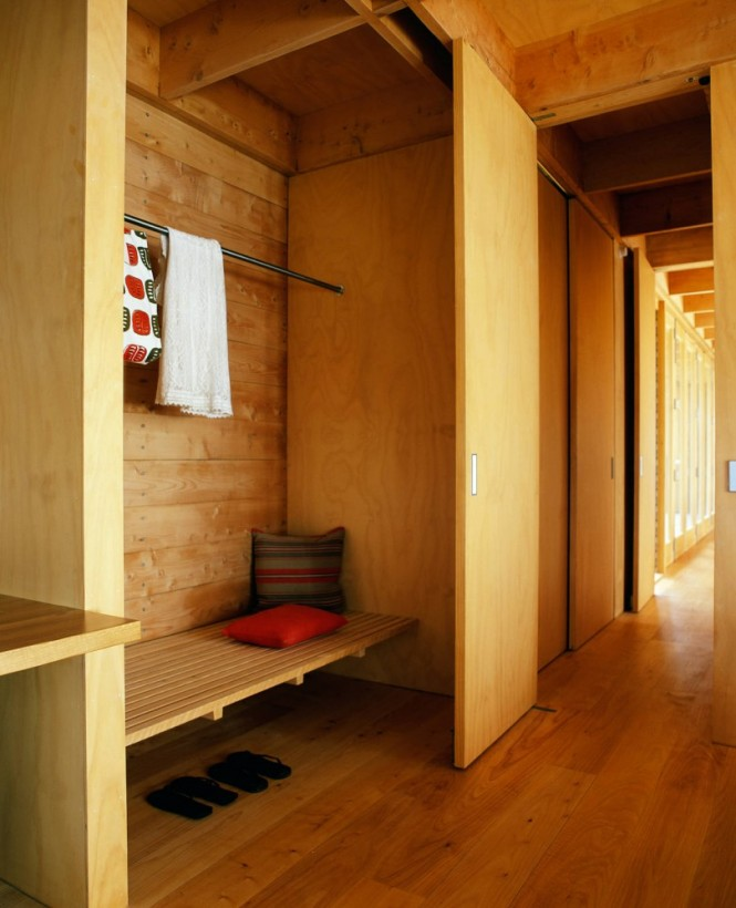 Wood clad hallway closet