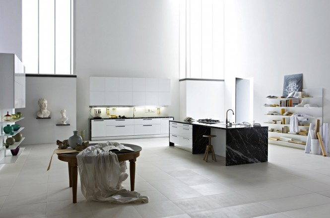 Artwork is just as beautiful in the kitchen as it is in any other part of the house, and these renaissance style sculpture busts offset the modernity of a gallery white kitchen superbly, where black marble worktops take on a classic plinth-like character, and a contrasting rustic table hints at an artists studio, surrounded by reference books and inspirational pieces.