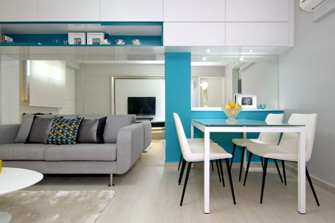 An aqua blue and yellow color play was devised to prevent the apartment from appearing too feminine, and bring a cool freshness to the once dowdy setting. Stylish accessories and unusual fabrics were layered in to add life and fun to the space.