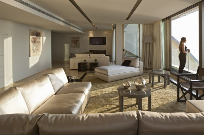 The furnishings throughout the entire home are by Armani Casa, using soft yet warm and tones to give a feeling of intimacy, whilst complimenting the vibrant sea and sky blues beyond.