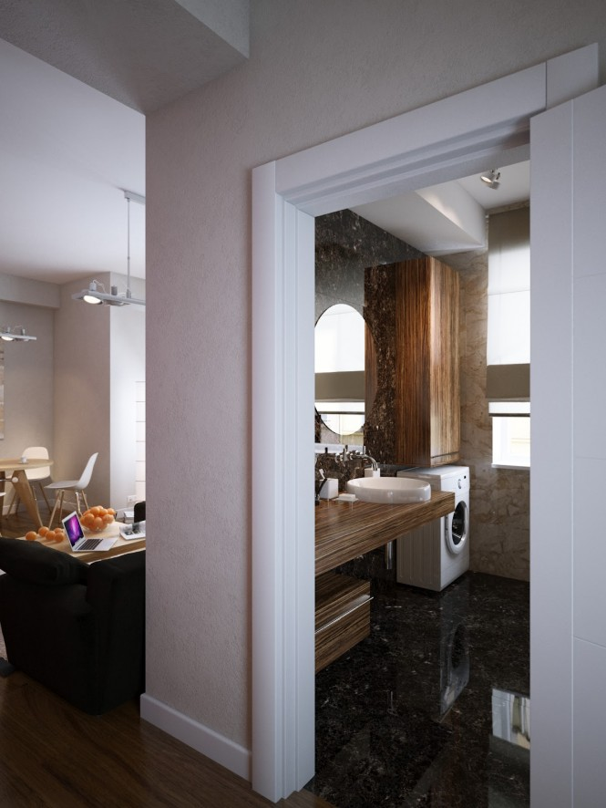 Off to the right, a sophisticated bathroom adds a dash of opulence to this apartment, with swathes of brown and cream marble across the entire floor and wall surfaces, creating a seamless effect.