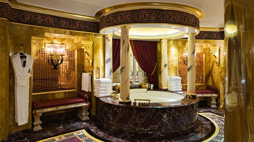 Arabian bath nights glitter with gold in this palatial scene.