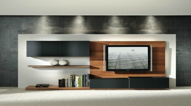Wooden wall cladding also brings beauty back to the technological TV zone of today's lounge, adding movement and interest behind cold digital gadgetry.