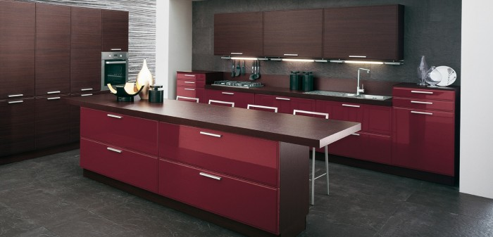 A note of burgundy wine gloss against deeper textures conjures an expensive look, which can be played on beautifully by moody gray walls.
