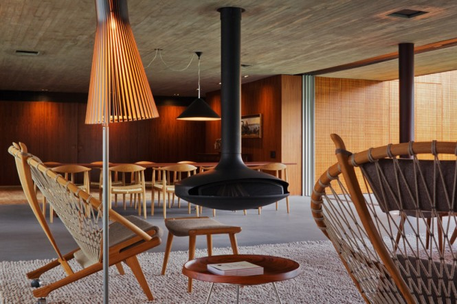The interior is set out with laid back Scandinavian vintage furniture, and decorated in natural wall textures to compliment the natural stone and concrete build, and the natural backdrop of the garden.