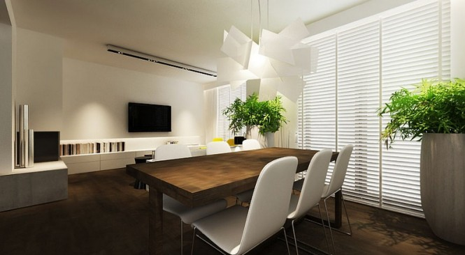 When going for a beautifully sleek and simple design like this dining room, remember to create an interesting focal point, as illustrated here by the oversized and sculptural pendant light; just one well placed and generously proportioned piece can completely change the image of a smooth ensemble.