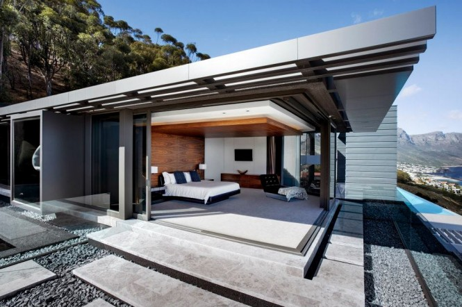 Perched high over Clifton, the beautifully modern home is flanked on the east edge by a hillside garden, whilst the western aspect looks out over the expansive Atlantic Ocean, visible from a huge sun patio, generous living space and a master bedroom with a retractable glass perimeter.
