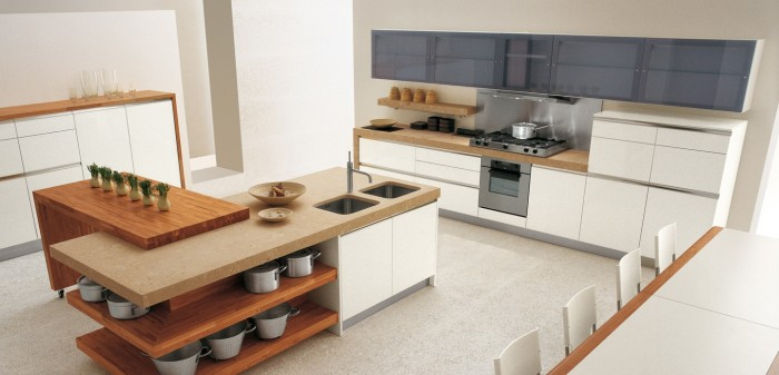 Natural wooden hues warm up a white kitchen, and a combination of an oak kitchen island and worktops against pale units provides tonal balance.