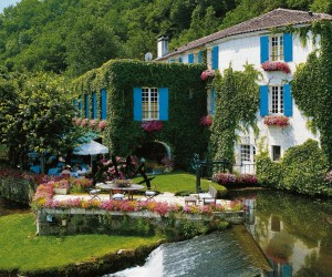 "Brantôme, known as the ""Venice of the Périgord"" because of it's winding waterways, is a stunning spot where the 16th century masterpiece that is the quirky right-angled stone bridge known as Pont Coudé links the ancient abbey with the monastery garden as well as the medieval tower, the Renaissance pavilion and the abbey itself."