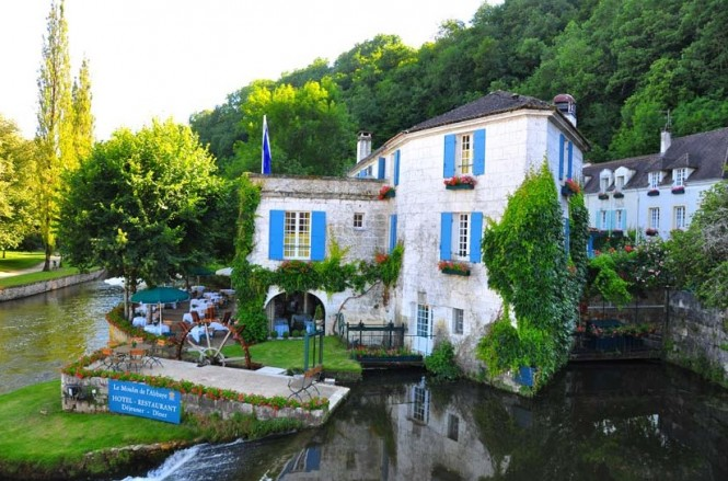 A riverside terrace shaded by mature trees houses a restaurant for the hotel guests and passing diners, providing the opportunity to while away the hours by the babbling River Dronne, where an old water wheel rolls lazily around.